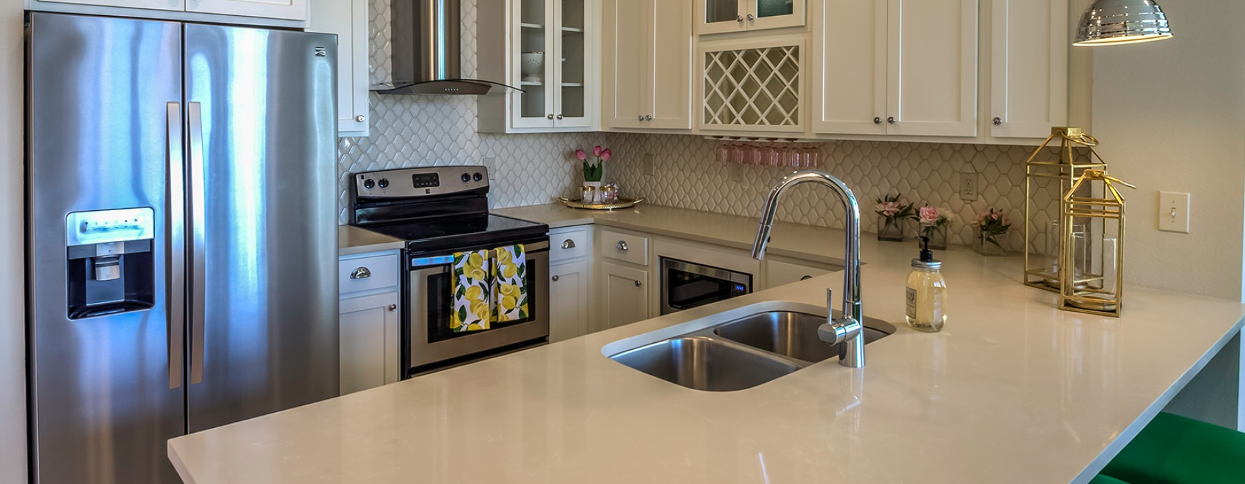 Kitchen with pendent lighting and peninsula with sink.