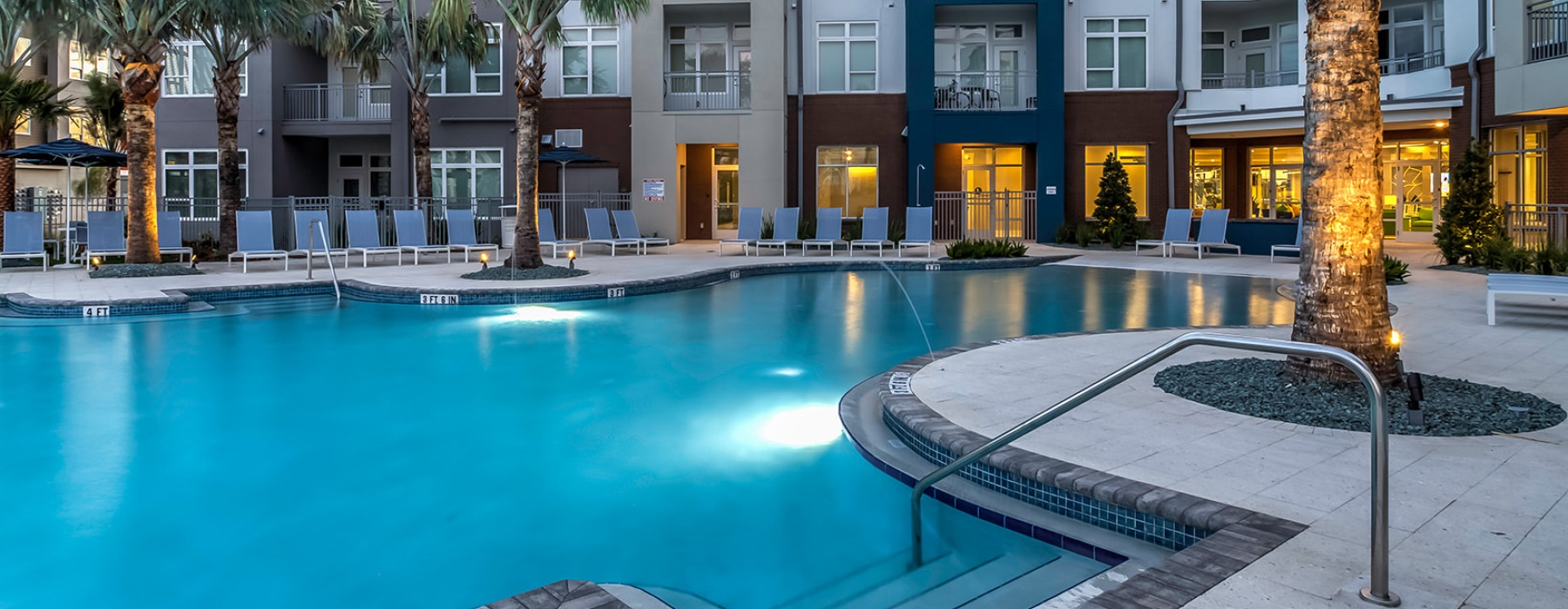 Large pool with poolside lounge chairs.